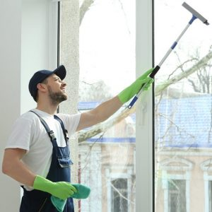 Man cleaning the window