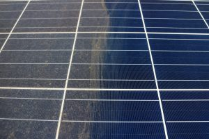 window az company shows clean solar panel after recent cleaning with reflection of mountains