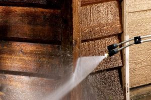 power washing tool washes wood siding on a prescott valley business